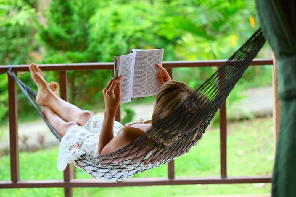 girl laying in a hammock